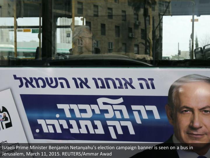 Israeli Prime Minister Benjamin Netanyahu's election campaign banner is seen on a bus in Jerusalem, March 11, 2015. REUTERS/Ammar Awad