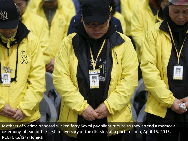 Mothers of victims onboard sunken ferry Sewol pay silent tribute as they attend a memorial ceremony, ahead of the first anniversary of the disaster, at a port in Jindo, April 15, 2015. REUTERS/Kim Hong-Ji