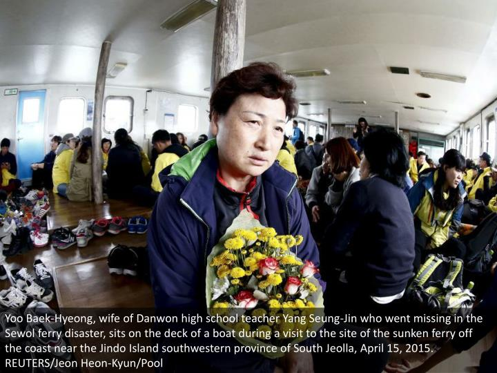 Yoo Baek-Hyeong, wife of Danwon high school teacher Yang Seung-Jin who went missing in the Sewol ferry disaster, sits on the deck of a boat during a visit to the site of the sunken ferry off the coast near the Jindo Island southwestern province of South Jeolla, April 15, 2015. REUTERS/Jeon Heon-Kyun/Pool