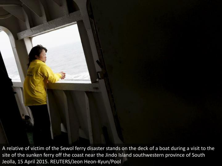A relative of victim of the Sewol ferry disaster stands on the deck of a boat during a visit to the site of the sunken ferry off the coast near the Jindo Island southwestern province of South Jeolla, 15 April 2015. REUTERS/Jeon Heon-Kyun/Pool