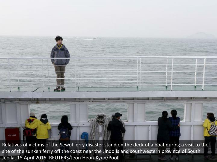 Relatives of victims of the Sewol ferry disaster stand on the deck of a boat during a visit to the site of the sunken ferry off the coast near the Jindo Island southwestern province of South Jeolla, 15 April 2015. REUTERS/Jeon Heon-Kyun/Pool