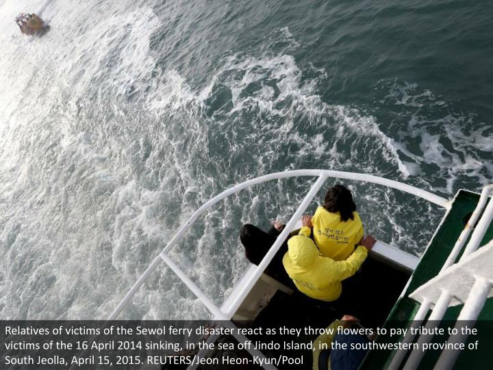 Relatives of victims of the Sewol ferry disaster react as they throw flowers to pay tribute to the victims of the 16 April 2014 sinking, in the sea off Jindo Island, in the southwestern province of South Jeolla, April 15, 2015. REUTERS/Jeon Heon-Kyun/Pool