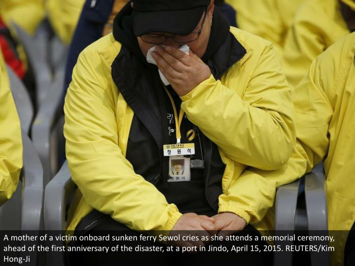 A mother of a victim onboard sunken ferry Sewol cries as she attends a memorial ceremony, ahead of the first anniversary of the disaster, at a port in Jindo, April 15, 2015. REUTERS/Kim Hong-Ji