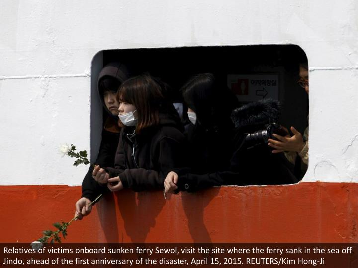 Relatives of victims onboard sunken ferry Sewol, visit the site where the ferry sank in the sea off Jindo, ahead of the first anniversary of the disaster, April 15, 2015. REUTERS/Kim Hong-Ji
