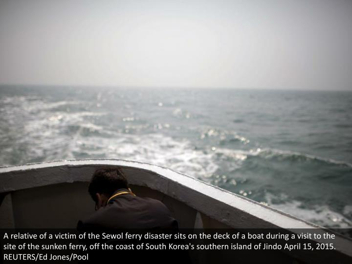 A relative of a victim of the Sewol ferry disaster sits on the deck of a boat during a visit to the site of the sunken ferry, off the coast of South Korea's southern island of Jindo April 15, 2015. REUTERS/Ed Jones/Pool