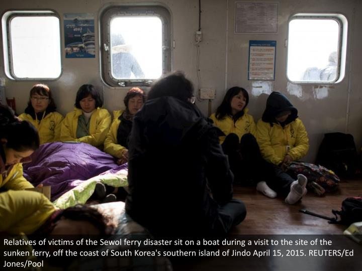 Relatives of victims of the Sewol ferry disaster sit on a boat during a visit to the site of the sunken ferry, off the coast of South Korea's southern island of Jindo April 15, 2015. REUTERS/Ed Jones/Pool