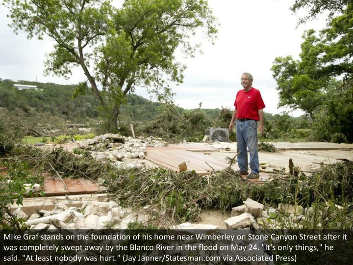 "Mike Graf stands on the foundation of his home near Wimberley on Stone Canyon Street after it was completely swept away by the Blanco River in the flood on May 24. ""It's only things,"" he said. ""At least nobody was hurt."" (Jay Janner/Statesman.com via Associated Press)"