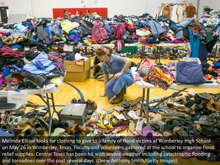 Melinda Ellisor looks for clothing to give to a family of flood victims at Wimberley High School on May 26 in Wimberley, Texas. Faculty and volunteers gathered at the school to organize flood relief supplies. Central Texas has been hit with severe weather including catastrophic flooding and tornadoes over the past several days. (Drew Anthony Smith/Getty Images)