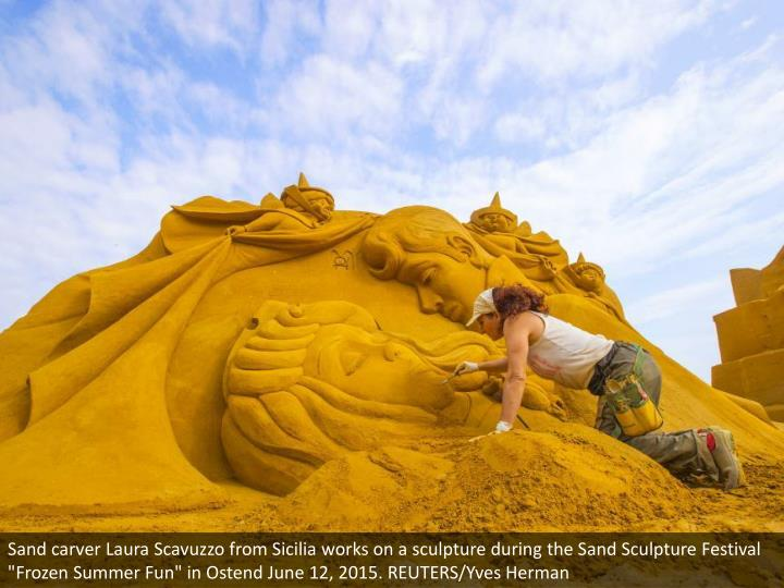 """Sand carver Laura Scavuzzo from Sicilia works on a sculpture during the Sand Sculpture Festival """"Frozen Summer Fun"""" in Ostend June 12, 2015. REUTERS/Yves Herman"""