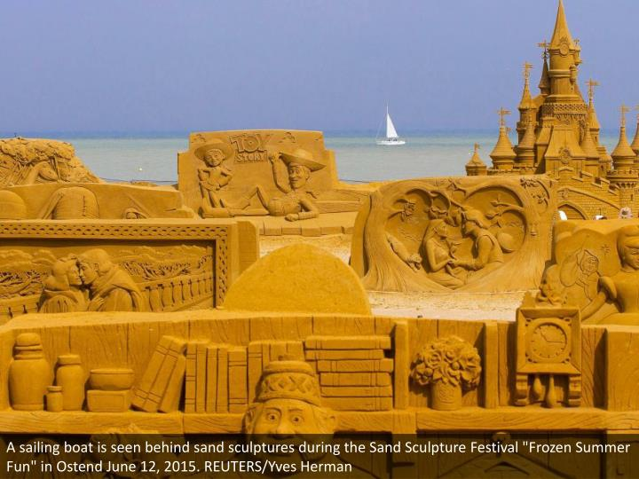 """A sailing boat is seen behind sand sculptures during the Sand Sculpture Festival """"Frozen Summer Fun"""" in Ostend June 12, 2015. REUTERS/Yves Herman"""