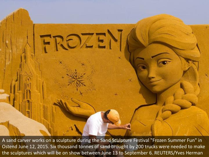 """A sand carver works on a sculpture during the Sand Sculpture Festival """"Frozen Summer Fun"""" in Ostend June 12, 2015. Six thousand tonnes of sand brought by 200 trucks were needed to make the sculptures which will be on show between June 13 to September 6. REUTERS/Yves Herman"""