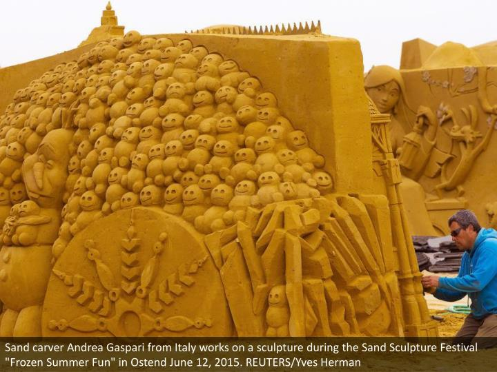 """Sand carver Andrea Gaspari from Italy works on a sculpture during the Sand Sculpture Festival """"Frozen Summer Fun"""" in Ostend June 12, 2015. REUTERS/Yves Herman"""