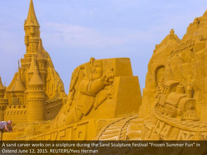 """A sand carver works on a sculpture during the Sand Sculpture Festival """"Frozen Summer Fun"""" in Ostend June 12, 2015. REUTERS/Yves Herman"""