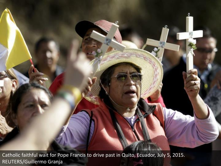 Catholic faithful wait for Pope Francis to drive past in Quito, Ecuador, July 5, 2015. REUTERS/Guillermo Granja