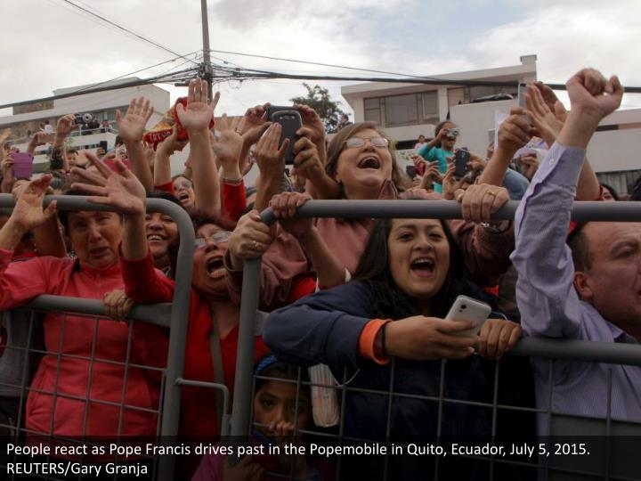 People react as Pope Francis drives past in the Popemobile in Quito, Ecuador, July 5, 2015. REUTERS/Gary Granja