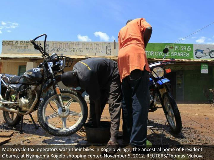 Motorcycle taxi operators wash their bikes in Kogelo village, the ancestral home of President Obama, at Nyangoma Kogelo shopping center, November 5, 2012. REUTERS/Thomas Mukoya