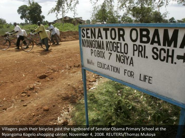Villagers push their bicycles past the signboard of Senator Obama Primary School at the Nyangoma Kogelo shopping center, November 4, 2008. REUTERS/Thomas Mukoya