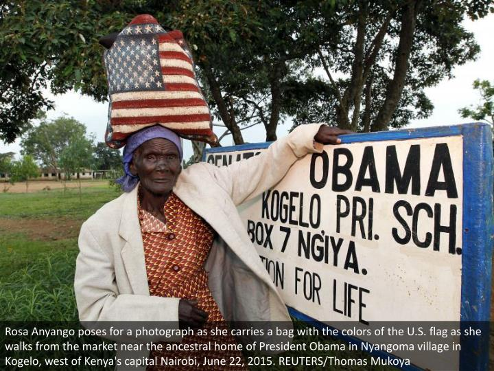 Rosa Anyango poses for a photograph as she carries a bag with the colors of the U.S. flag as she wal...