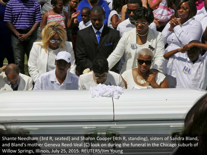 Shante Needham (3rd R, seated) and Sharon Cooper (4th R, standing), sisters of Sandra Bland, and Bla...
