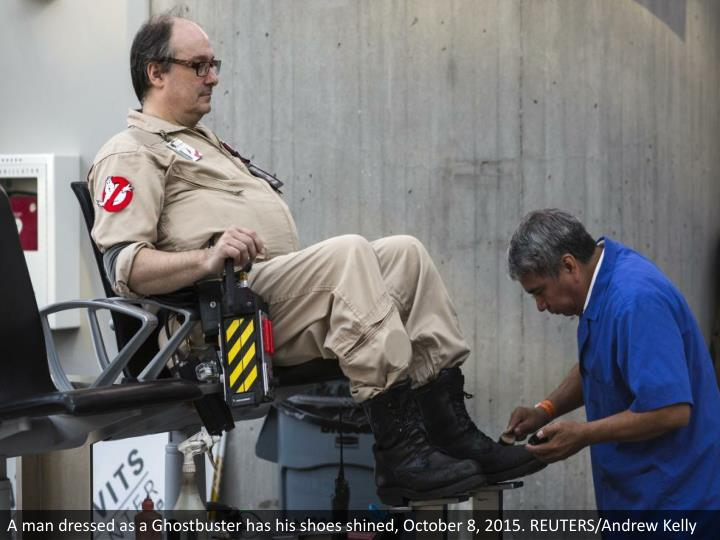A man dressed as a Ghostbuster has his shoes shined, October 8, 2015. REUTERS/Andrew Kelly