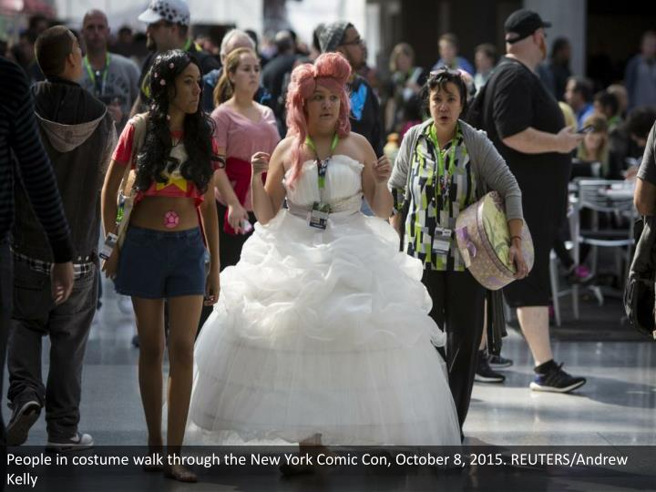 People in costume walk through the New York Comic Con, October 8, 2015. REUTERS/Andrew Kelly