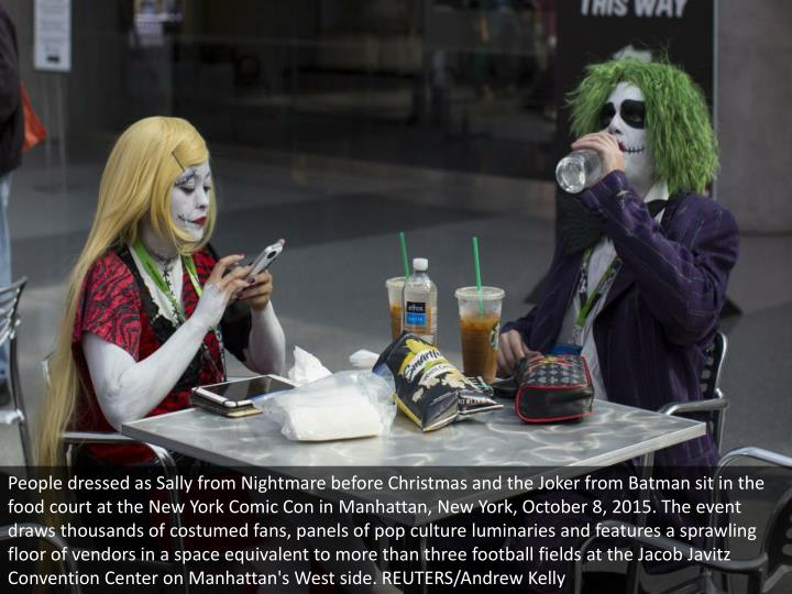 People dressed as Sally from Nightmare before Christmas and the Joker from Batman sit in the food co...