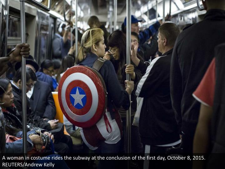 A woman in costume rides the subway at the conclusion of the first day, October 8, 2015. REUTERS/Andrew Kelly