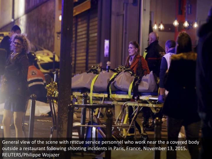 General view of the scene with rescue service personnel who work near the a covered body outside a restaurant following shooting incidents in Paris, France, November 13, 2015. REUTERS/Philippe Wojazer