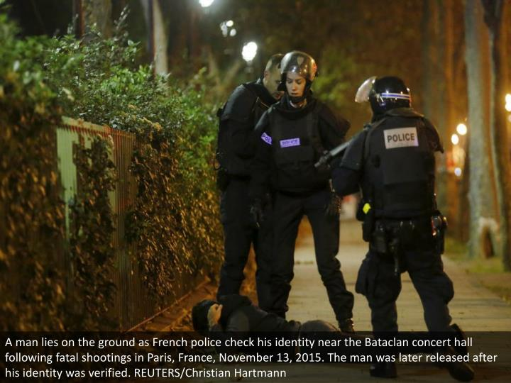 A man lies on the ground as French police check his identity near the Bataclan concert hall following fatal shootings in Paris, France, November 13, 2015. The man was later released after his identity was verified. REUTERS/Christian Hartmann