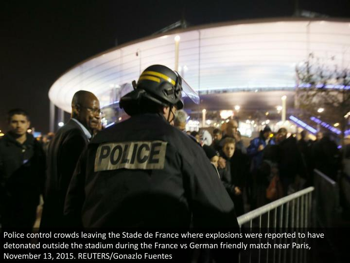 Police control crowds leaving the Stade de France where explosions were reported to have detonated outside the stadium during the France vs German friendly match near Paris, November 13, 2015. REUTERS/Gonazlo Fuentes