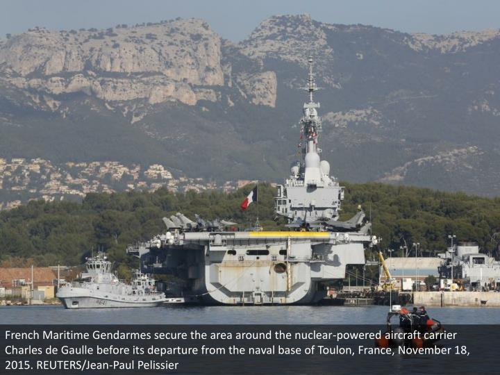 French Maritime Gendarmes secure the area around the nuclear-powered aircraft carrier Charles de Gaulle before its departure from the naval base of Toulon, France, November 18, 2015. REUTERS/Jean-Paul Pelissier