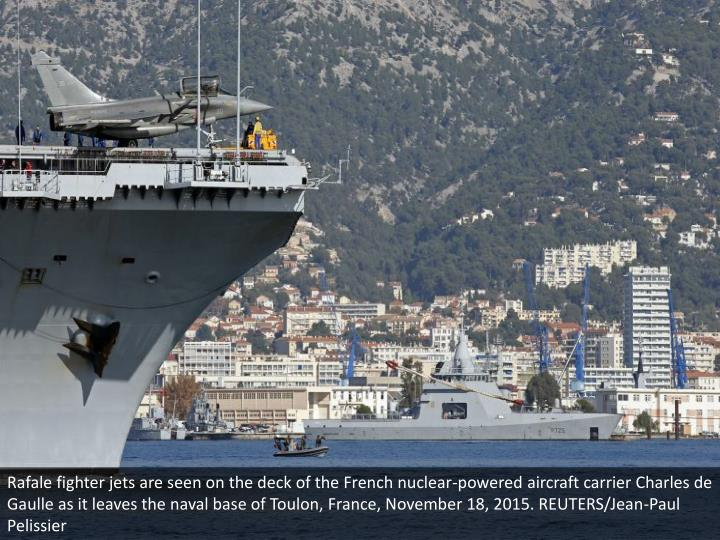 Rafale fighter jets are seen on the deck of the French nuclear-powered aircraft carrier Charles de Gaulle as it leaves the naval base of Toulon, France, November 18, 2015. REUTERS/Jean-Paul Pelissier
