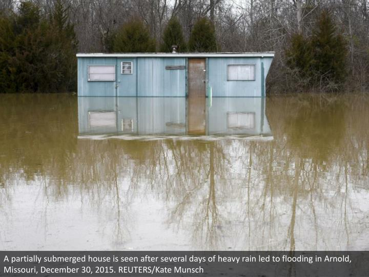A partially submerged house is seen after several days of heavy rain led to flooding in Arnold, Missouri, December 30, 2015. REUTERS/Kate Munsch