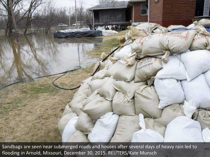 Sandbags are seen near submerged roads and houses after several days of heavy rain led to flooding in Arnold, Missouri, December 30, 2015. REUTERS/Kate Munsch