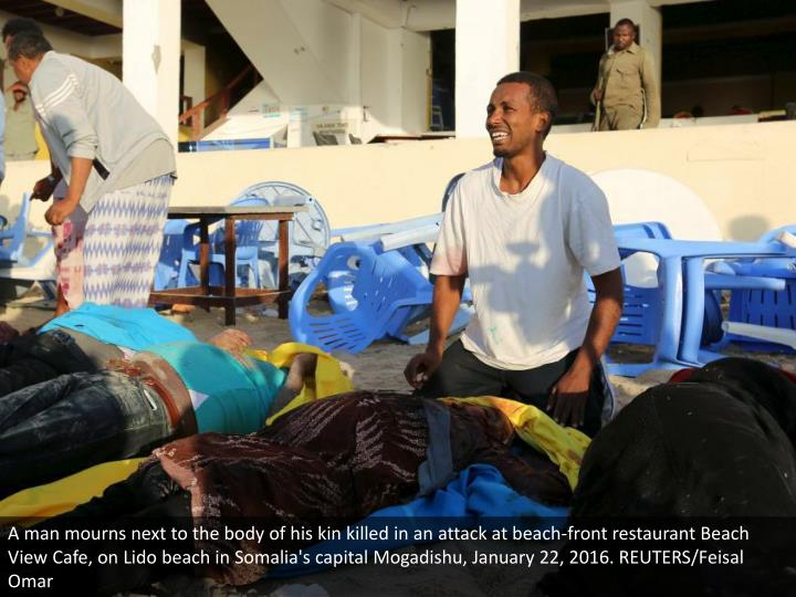A man mourns next to the body of his kin killed in an attack at beach-front restaurant Beach View Cafe, on Lido beach in Somalia's capital Mogadishu, January 22, 2016. REUTERS/Feisal Omar