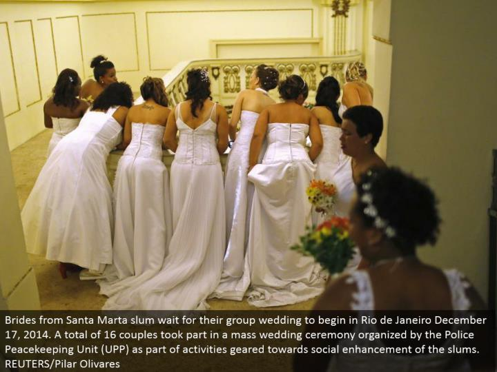 Brides from Santa Marta ghetto sit tight for their gathering wedding to start in Rio de Janeiro December 17, 2014. An aggregate of 16 couples participated in a mass wedding service sorted out by the Police Peacekeeping Unit (UPP) as a major aspect of exercises equipped towards social upgrade of the ghettos. REUTERS/Pilar Olivares