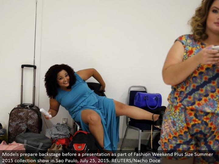 Models get ready backstage before a presentation as a major aspect of Fashion Weekend Plus Size Summ...