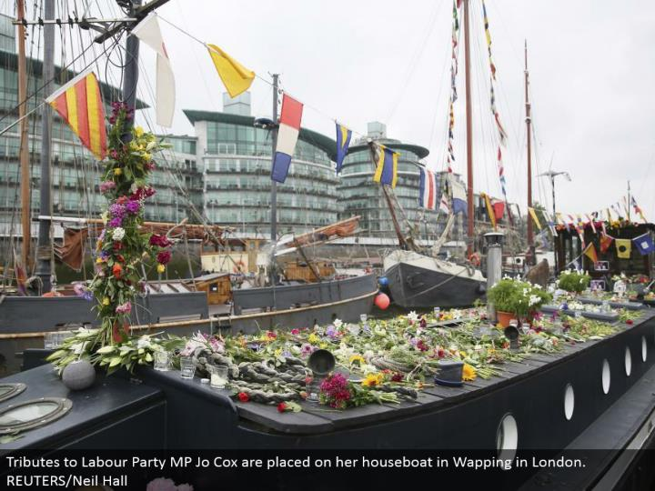 Tributes to Labor Party MP Jo Cox are put on her houseboat in Wapping in London. REUTERS/Neil Hall