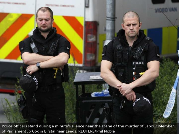 Police officers stand amid a moment's quiet close to the scene of the homicide of Labor Member of Parliament Jo Cox in Birstal close Leeds. REUTERS/Phil Noble