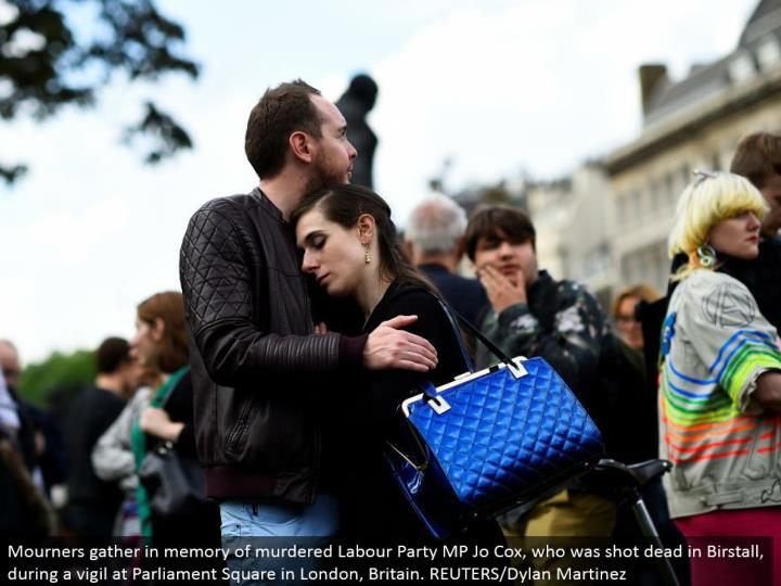 Mourners assemble in memory of killed Labor Party MP Jo Cox, who was shot dead in Birstall, amid a v...