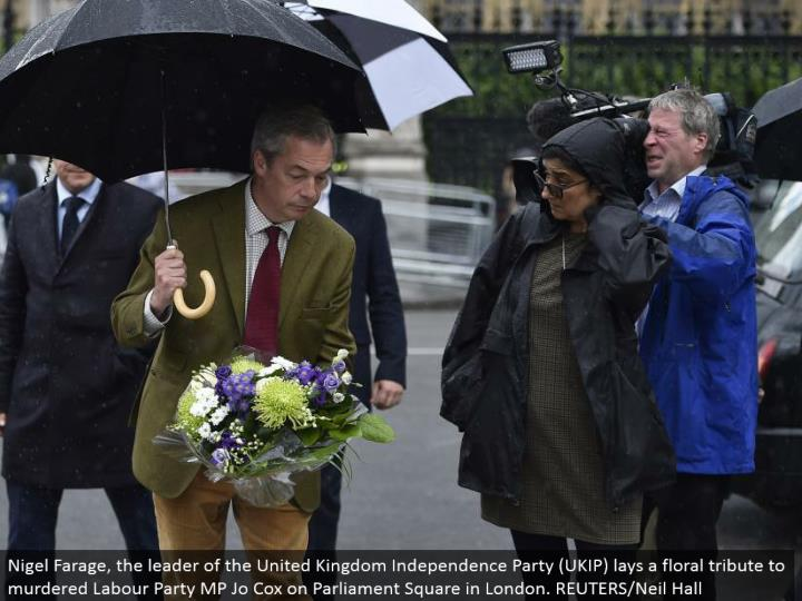 Nigel Farage, the pioneer of the United Kingdom Independence Party (UKIP) lays a botanical tribute to killed Labor Party MP Jo Cox on Parliament Square in London. REUTERS/Neil Hall
