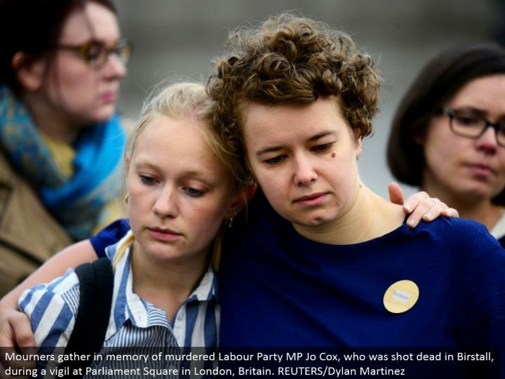 Mourners accumulate in memory of killed Labor Party MP Jo Cox, who was shot dead in Birstall, amid a vigil at Parliament Square in London, Britain. REUTERS/Dylan Martinez