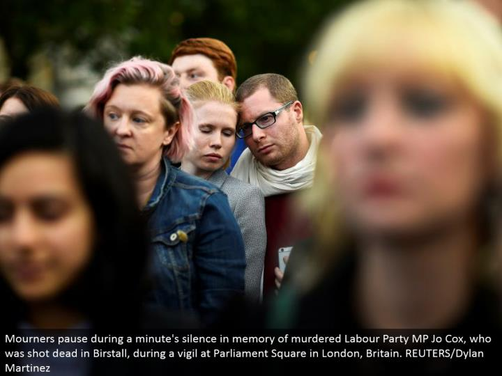 Mourners stop amid a moment's hush in memory of killed Labor Party MP Jo Cox, who was shot dead in Birstall, amid a vigil at Parliament Square in London, Britain. REUTERS/Dylan Martinez
