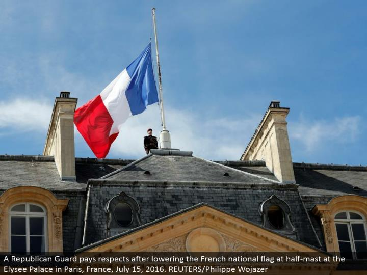 A Republican Guard pays regards in the wake of bringing down the French national banner at half-pole at the Elysee Palace in Paris, France, July 15, 2016. REUTERS/Philippe Wojazer