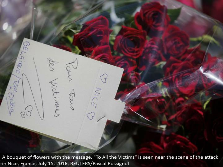 "A bundle of blooms with the message, ""To All the Victims"" is seen close to the scene of the assault in Nice, France, July 15, 2016. REUTERS/Pascal Rossignol"