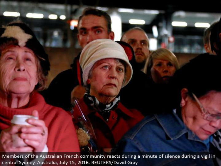 Members of the Australian French people group responds amid a moment of hush amid a vigil in focal Sydney, Australia, July 15, 2016. REUTERS/David Gray