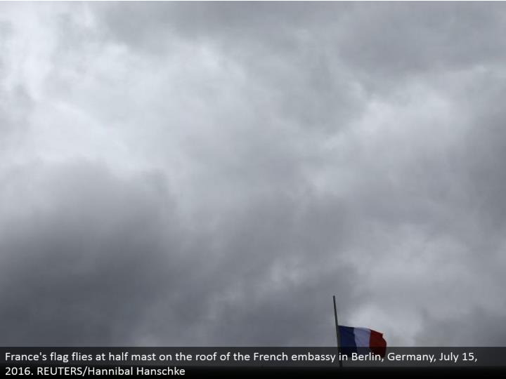 France's banner flies at half pole on the top of the French international safe haven in Berlin, Germany, July 15, 2016. REUTERS/Hannibal Hanschke