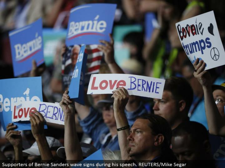Supporters of Bernie Sanders wave signs amid his discourse. REUTERS/Mike Segar