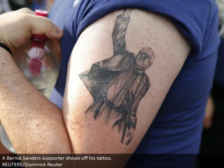 A Bernie Sanders supporter flaunts his tattoo.  REUTERS/Dominick Reuter