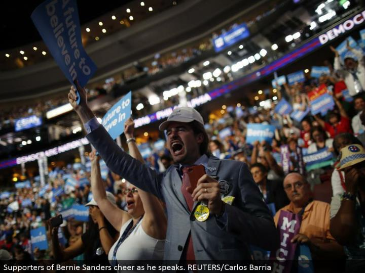 Supporters of Bernie Sanders cheer as he talks. REUTERS/Carlos Barria